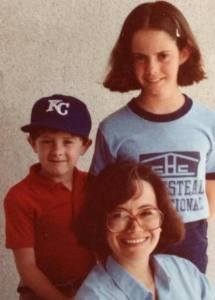 Wearing KC hat when I'm 3 or 5, with big sister and mom.