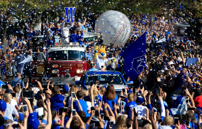 Kansas City Royals mascot Sluggerrr waves to fans during a World Series victory parade in Kansas City, Mo., Tuesday, Nov. 3, 2015. (AP Photo/Orlin Wagner)