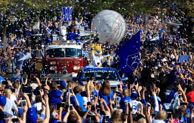 Kansas City Royals mascot Sluggerrr waves to fans during a World Series victory parade in Kansas City, Mo., Tuesday, Nov. 3, 2015. (AP Photo/Orlin Wagner)